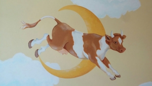 Sweet cow jumps over the moon in a nursery area