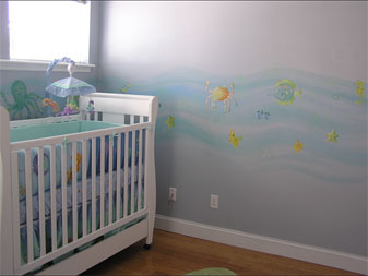 Pastel sea life swims simply in this restful room.